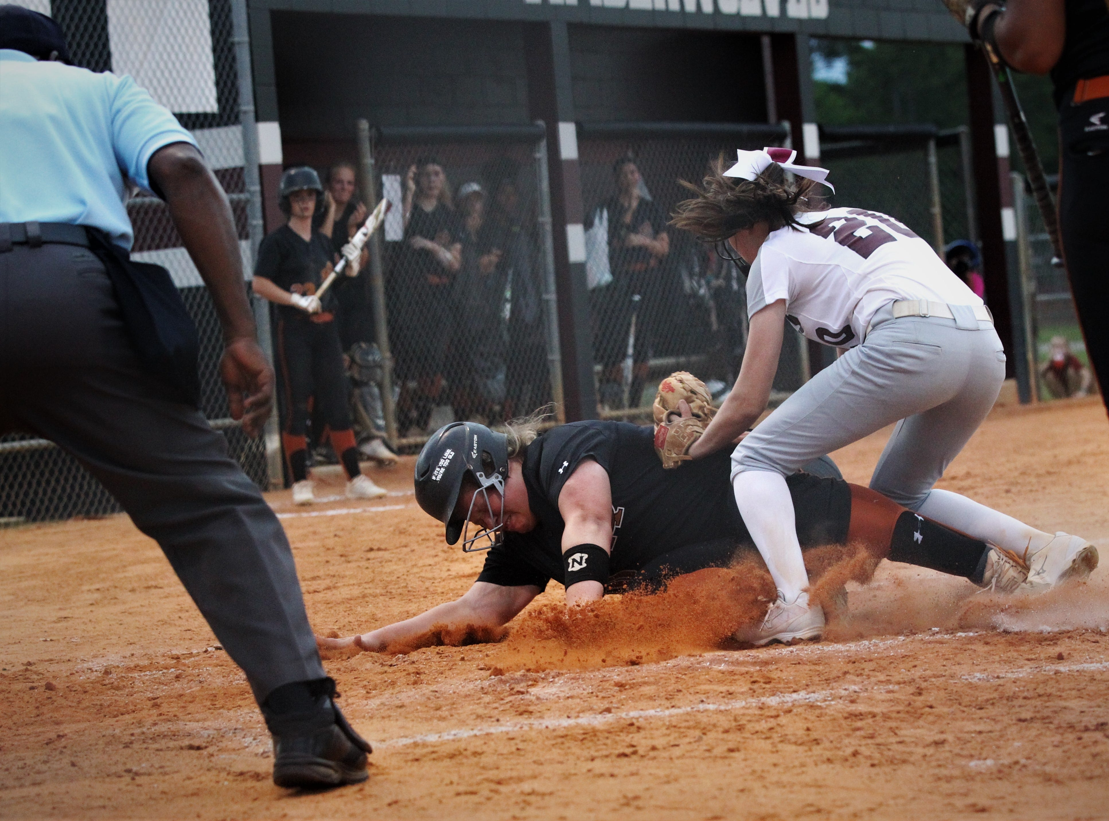 Chiles pitcher Dani Bauer tries to make a tag at home plate after a passed ball as the Timberwolves beat Atlantic Coast 6-4 during a Region 1-8A quarterfinal softball game on Wednesday, May 8, 2019.