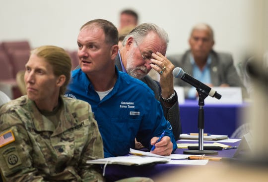 Okeechobee County Commissioner Terry Burroughs (right) listens as stakeholders talk about the current and future impact of a low Lake Okeechobee water level Tuesday, May 7, 2019, during a joint commission meeting at Okeechobee High School. Hendry County Commissioner Karson Turner (center) and Army Corps of Engineers Jacksonville District deputy commander Lt. Col. Jennifer Reynolds sit beside Burroughs. Fellow commissioners from Martin, Palm Beach and Glades counties also attended, as well as a representative from Rep. Brian Mast's office.