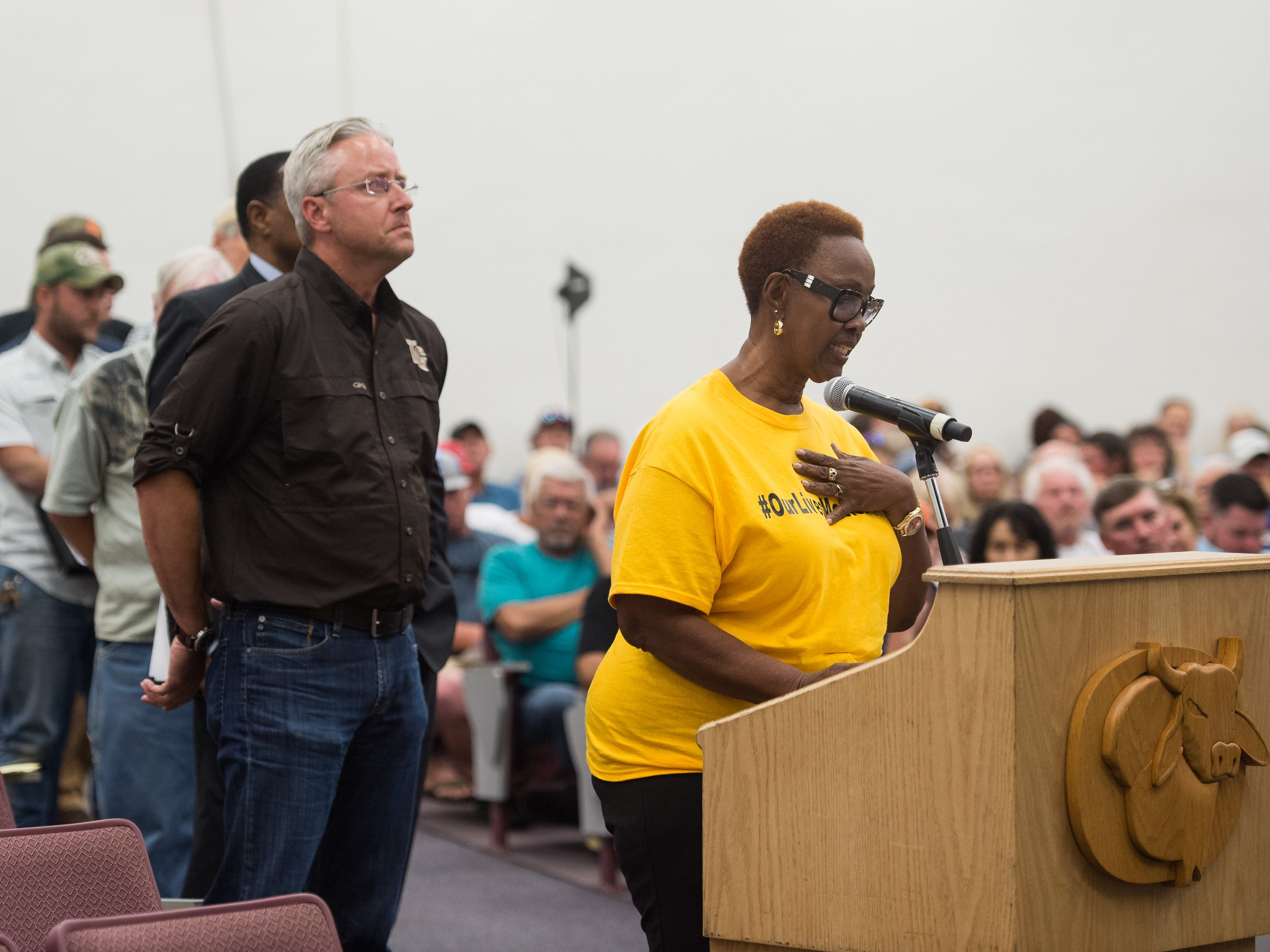 """Janet Taylor, a former Hendry County commissioner and head of Glades Lives Matter, speaks during a joint commission meeting at Okeechobee High School on Tuesday, May 7, 2019, followed by Martin County resident and former South Florida Water Management District governing board member Brandon Tucker. Taylor said """"we can solve these problems as brothers and sisters committed to this common cause, but we cannot solve these problems without a little understanding from people in these coastal ivory towers."""" County commissioners from Martin, Palm Beach, Glades, Hendry and Okeechobee attended the meeting, where stakeholders voiced their concerns following statements from the Army Corps of Engineers and Rep. Brian Mast's office."""