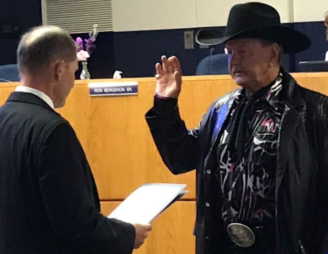 """Ronald """"Alligator Ron"""" Bergeron, right, is sworn in Thursday, May 9, 2019, as a member of the South Florida Water Management District board by Chairman Chauncey Goss."""