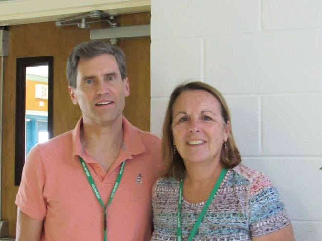 Volunteers Mike and Jackie Rose at the Gifford Youth Achievement Center.