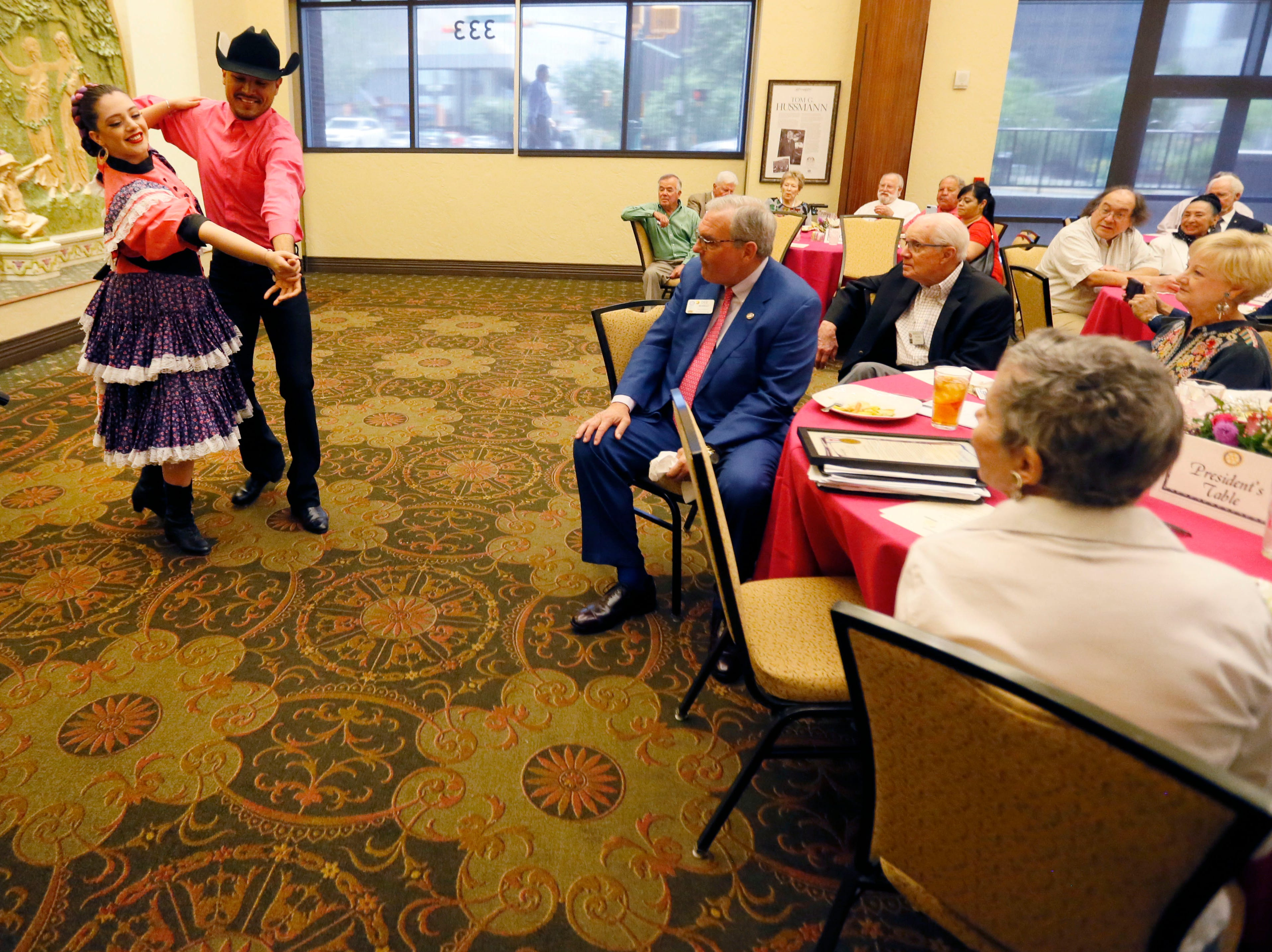 Mariana Fernandez and Ricardo Gallegos perform folklorico for the Rotary Club of El Paso before Rosa Guerrero is awarded the Distinguished Service Award Thursday, May 9, at the El Paso Community Foundation Room.
