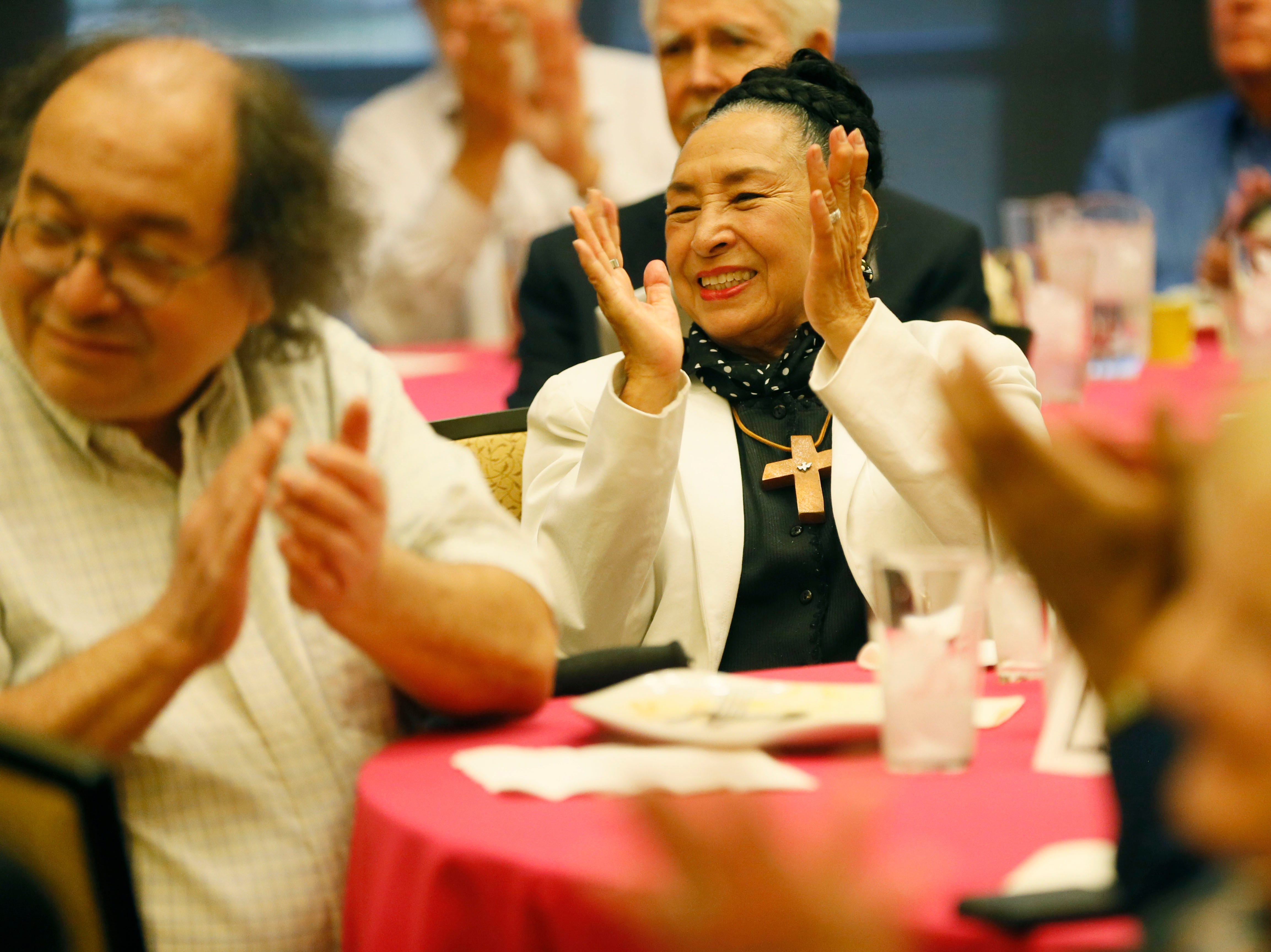 Rosa Guerrero applauds for the folklorico performance during the Rotary Club of El Paso Distinguished Service Award Thursday, May 9, at the El Paso Community Foundation Room.