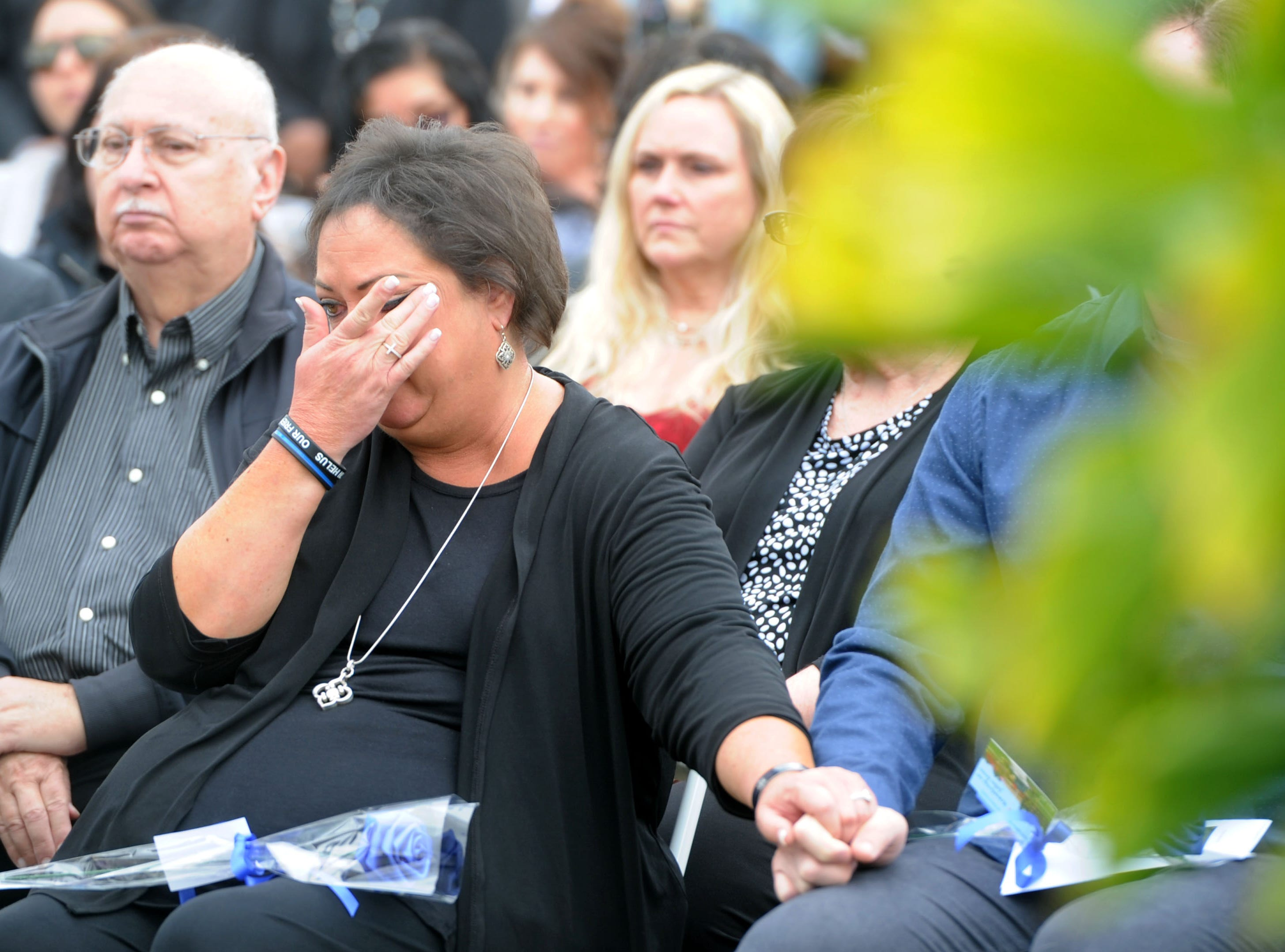 Sgt. Ron Helus' widow, Karen Helus, cries Thursday at the Ventura County Peace Officers Memorial at the Ventura County Government Center. The sergeant was one of those who died as a result of the mass shooting at the Borderline Bar & Grill in Thousand Oaks.