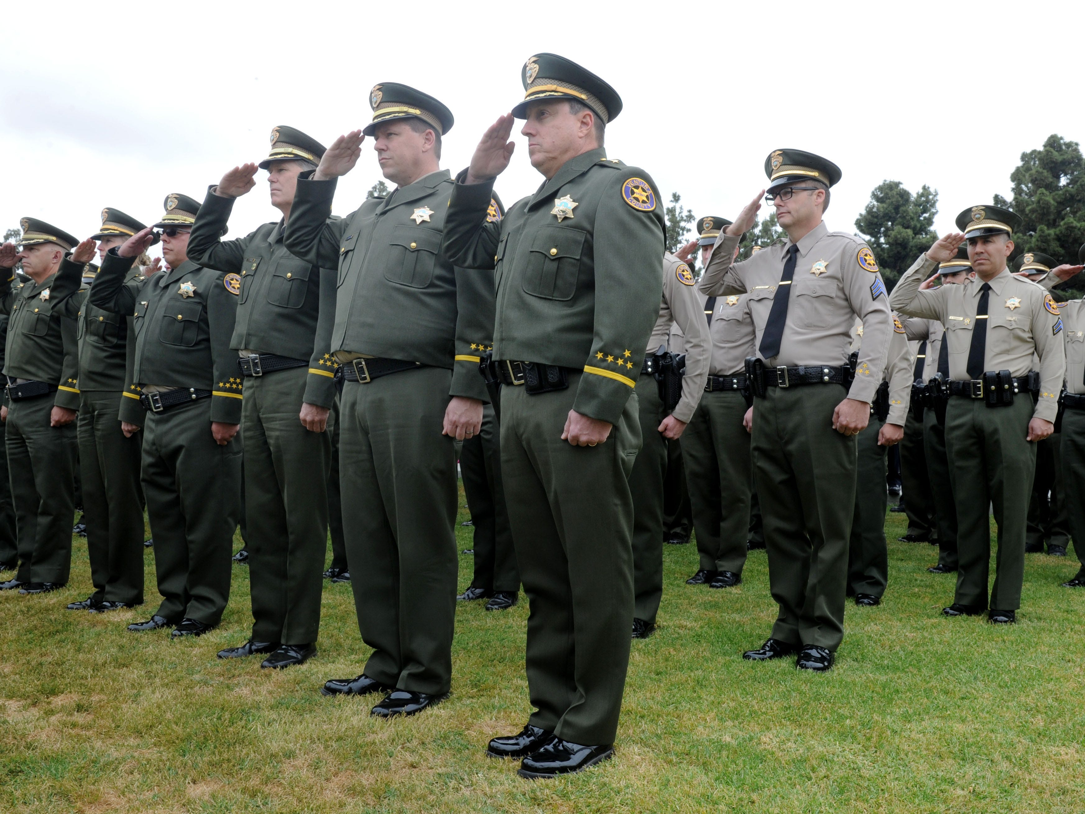 A large group of sheriff's officers salute at the Ventura County Peace Officers Memorial on Thursday at the Ventura County Government Center.