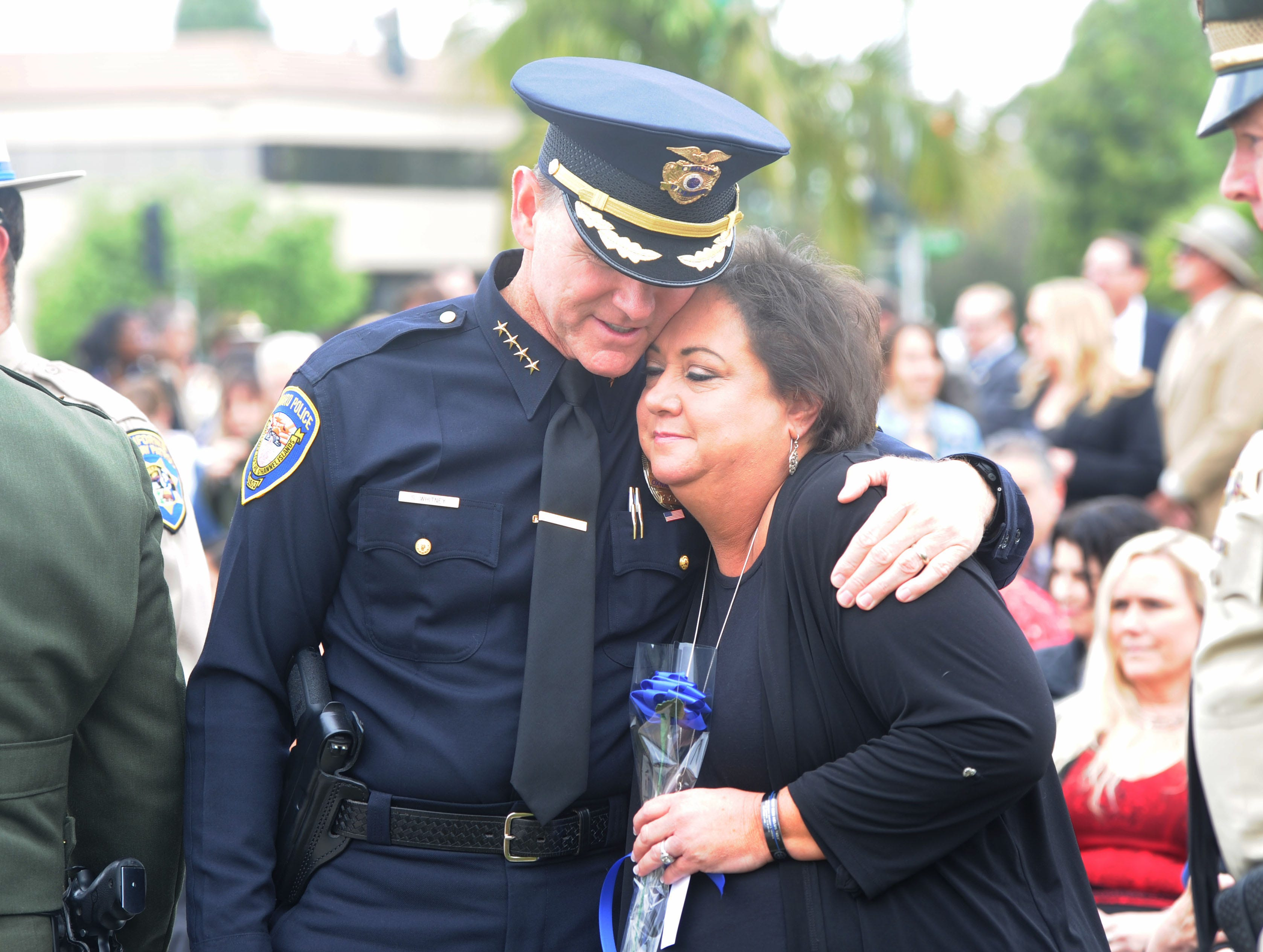Oxnard Police Chief Scott Whitney hugs Karen Helus on Thursday at the Ventura County Peace Officers Memorial. The late sheriff's Sgt. Ron Helus was among those honored.
