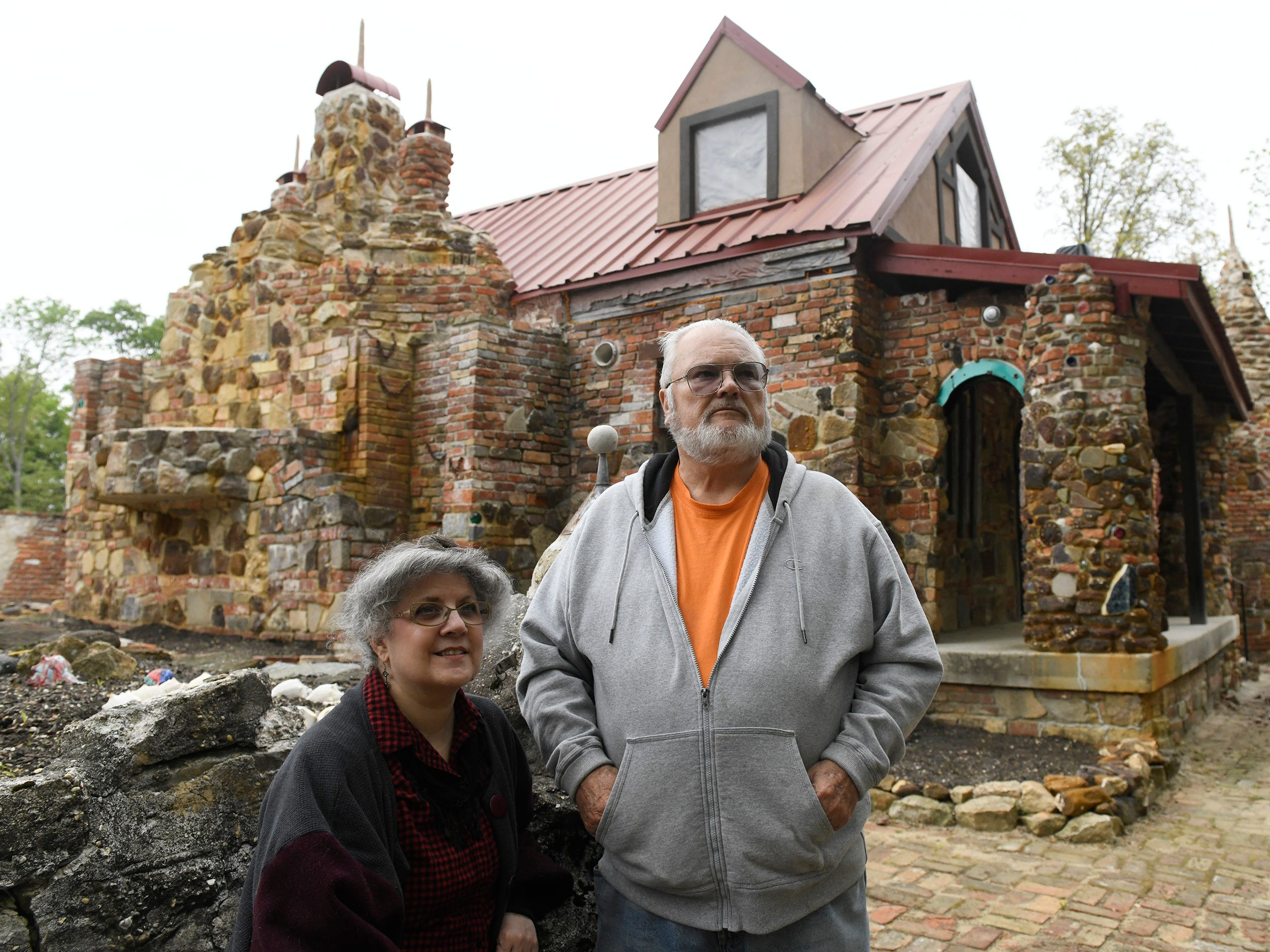 """Founder's Day coordinator Kathryn Ross and Kevin J. Kirchner, president of the Palace of Depression Restoration Association, stand inside """"The Strangest House in the World"""" on Thursday, May 9, 2019."""