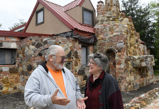 """Kevin J. Kirchner, president of the Palace of Depression Restoration Association and Founder's Day coordinator Kathryn Ross stand outside """"The Strangest House in the World"""" on Thursday, May 9, 2019."""