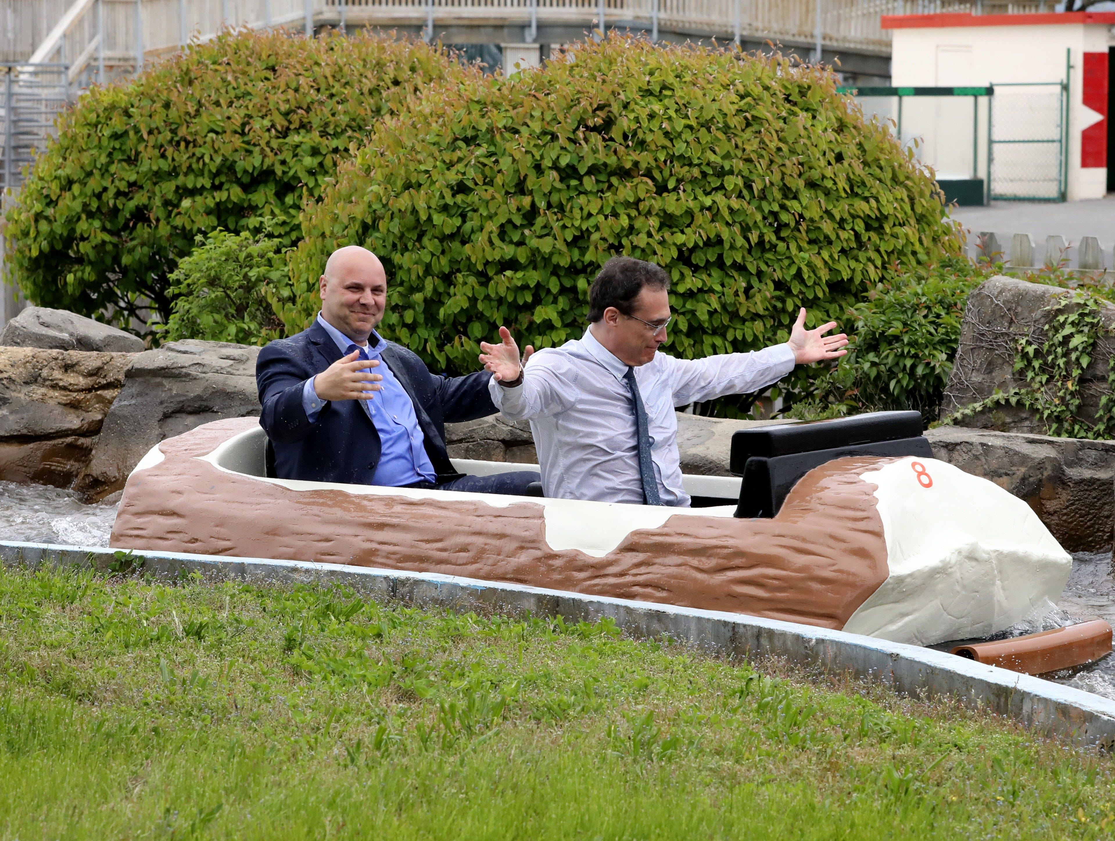 """Peter Tartaglia, front, the deputy commissioner of Westchester County Parks and Frank Carrieri, the general manager at Playland, are soaked after riding the Log Flume during a """"ride and food safety tour"""" for the media, at Playland in Rye, May 9, 2019."""