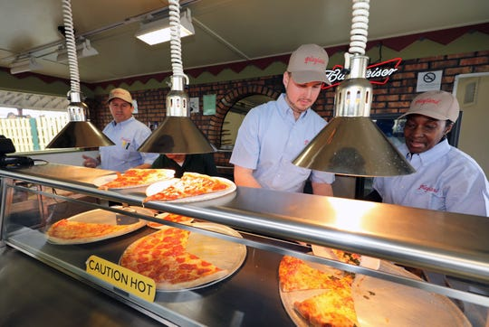 "Fresh pizza is served at a food booth during a ""ride and food safety tour"" for the media, at Playland in Rye, May 9, 2019."