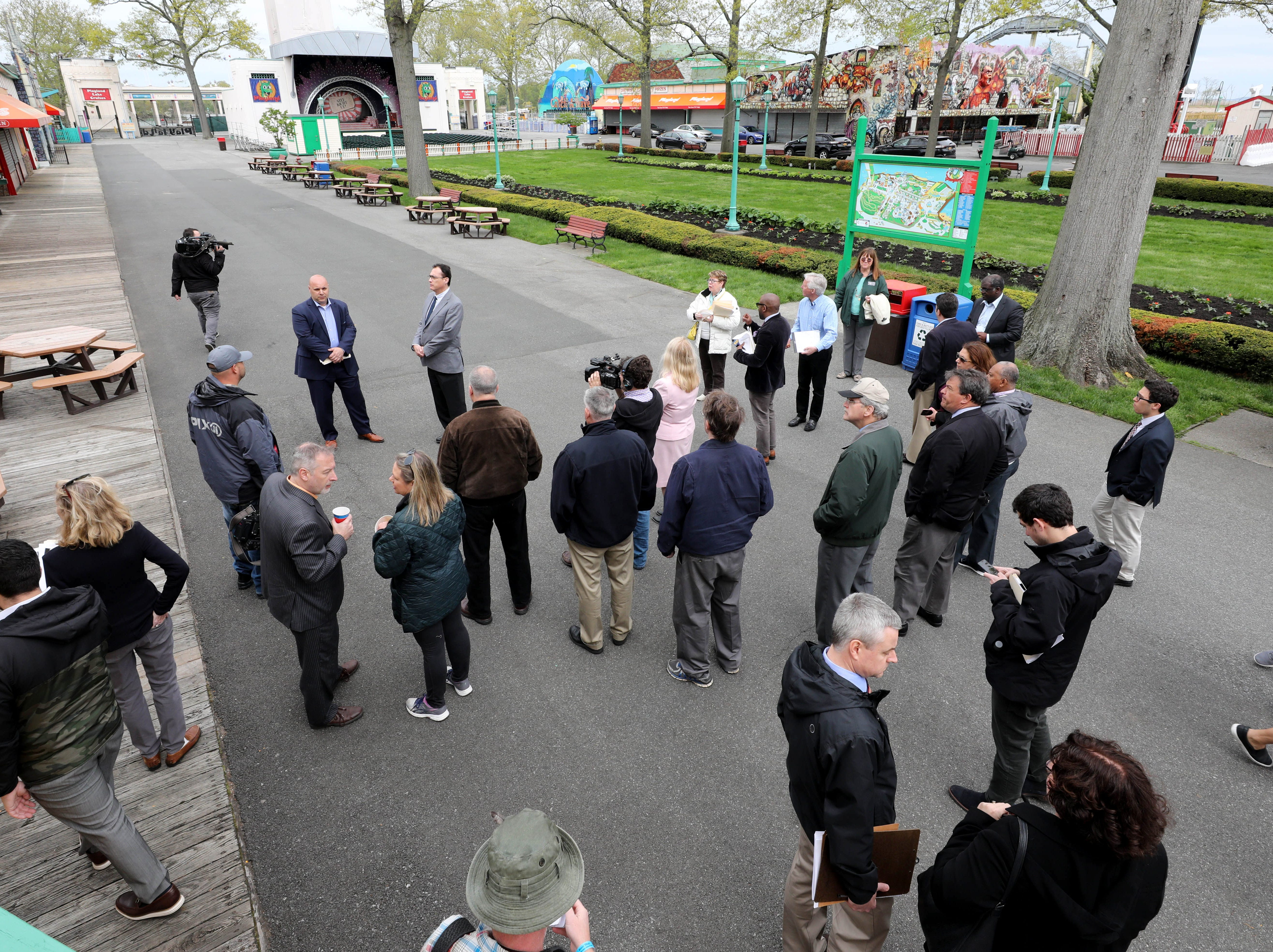 """Frank Carrieri, the general manager at Playland, and Peter Tartaglia, the deputy commissioner of Westchester County Parks, lead a tour during a """"ride and food safety tour"""" for the media, at Playland in Rye, May 9, 2019."""