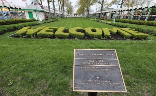 The National Historic Marker and the welcome sign made from shrubbery, at Playland in Rye, May 9, 2019.