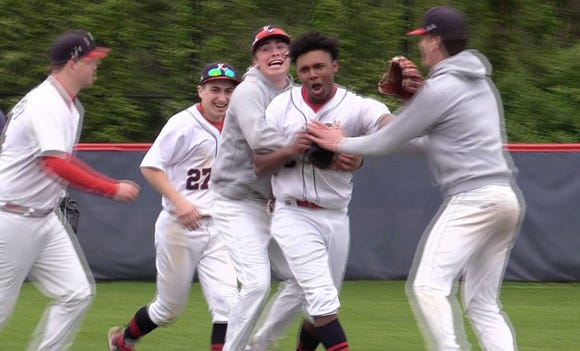Kennedy's Myles Proctor celebrates with teammates after the final out against Iona Prep during action at Kennedy Catholic in Somers May 9, 2019. Proctor took part in recording all three outs of the final inning to seal Kennedy's 5-4 victory.