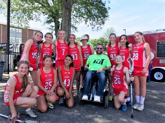 Tony Ciccone with some of the players from a past Laxin4Tony tournament.jpg
