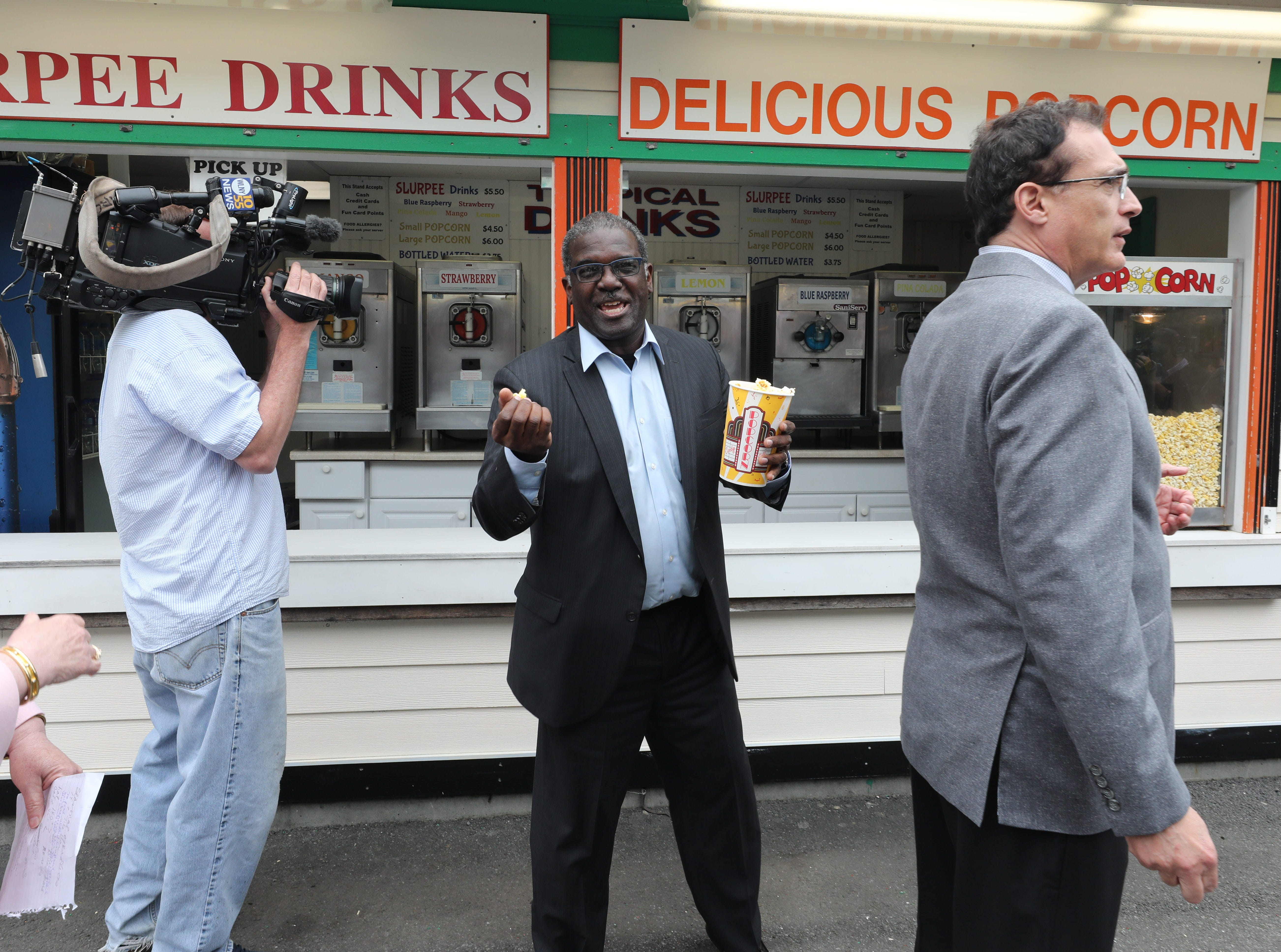 """Ken Jenkins, the Westchester County Deputy County Executive, samples the popcorn during a """"ride and food safety tour"""" for the media, at Playland in Rye, May 9, 2019."""
