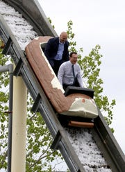 "Peter Tartaglia, front, the deputy commissioner of Westchester County Parks and Frank Carrieri, the general manager at Playland, ride the Log Flume during a ""ride and food safety tour"" for the media, at Playland in Rye, May 9, 2019."