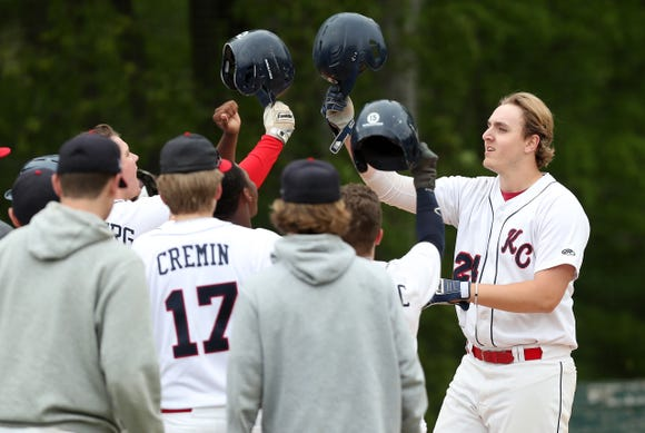 Kennedy's Eric Volpe is greeted at home after hitting a 2-run homer in the first inning against Iona Prep during action at Kennedy Catholic in Somers May 9, 2019. Kennedy  won the game 5-4.