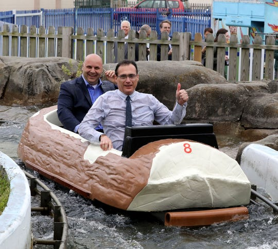 "Peter Tartaglia, front, the deputy commissioner of Westchester County Parks and Frank Carrieri, the general manager at Playland, are soaked after riding the Log Flume during a ""ride and food safety tour"" for the media, at Playland in Rye, May 9, 2019."