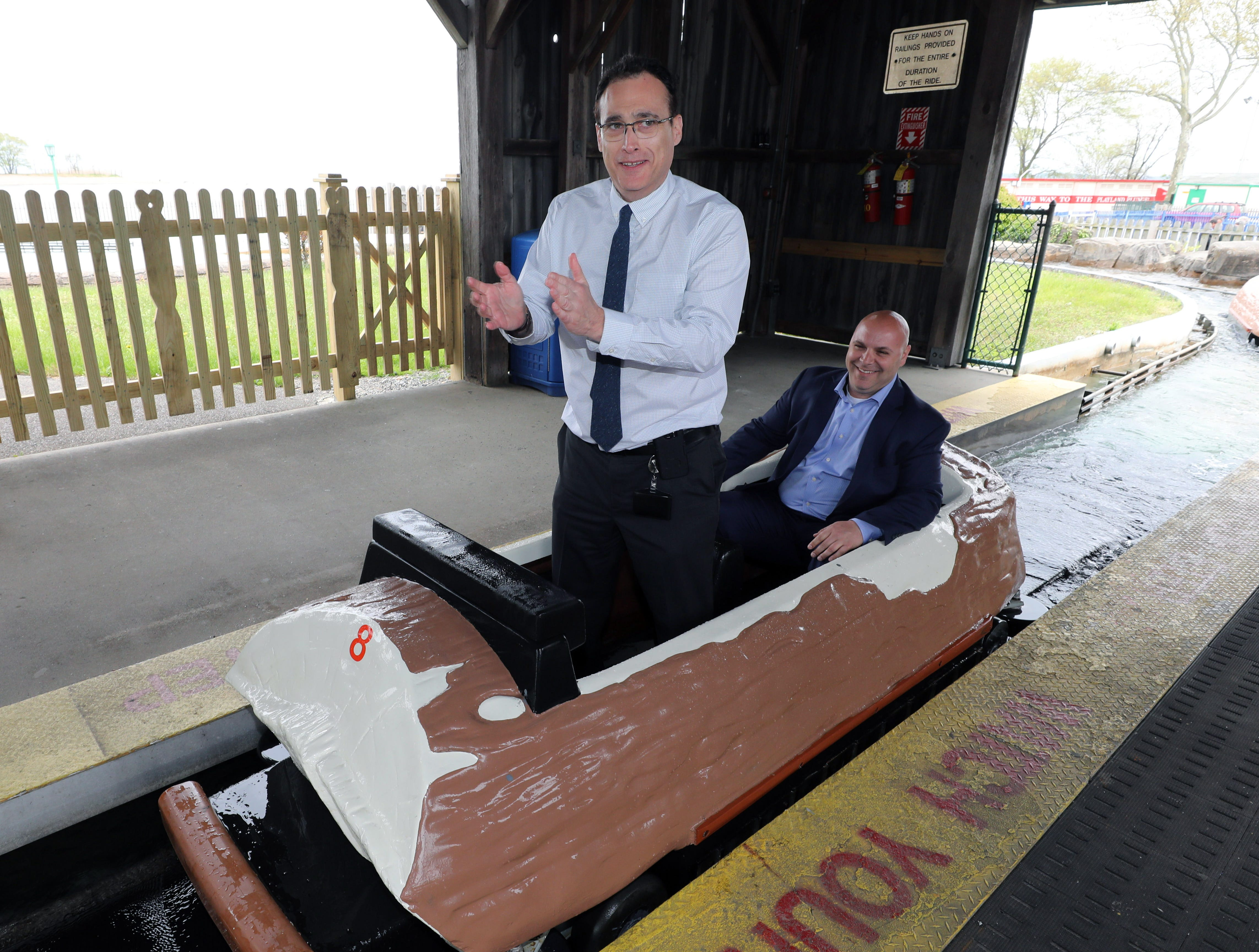 """Peter Tartaglia, the deputy commissioner of Westchester County Parks and Frank Carrieri, the general manager at Playland, board the Log Flume during a """"ride and food safety tour"""" for the media, at Playland in Rye, May 9, 2019."""
