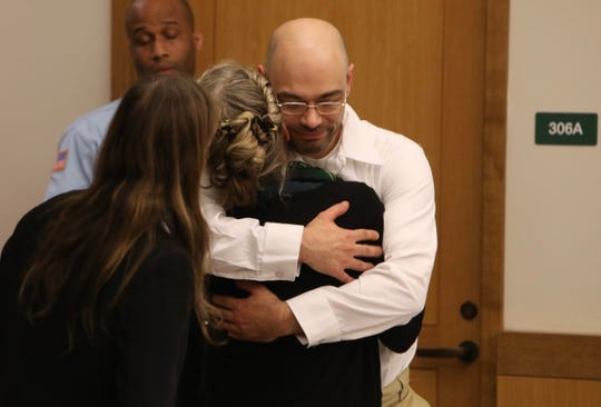 Andrew Krivak hugs his attorney after finding out a judge had overturned his 1997 conviction in the rape and murder of 12-year-old Josette Wright in Putnam County.
