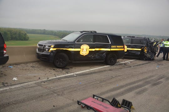 Two state troopers were injured after a four-vehicle, chain-reaction crash on the Del. 1 Roth Bridge early Wednesday morning. Both troopers were hospitalized and released. The truck driver who state police said caused the crash was ticketed for inattentive driving.