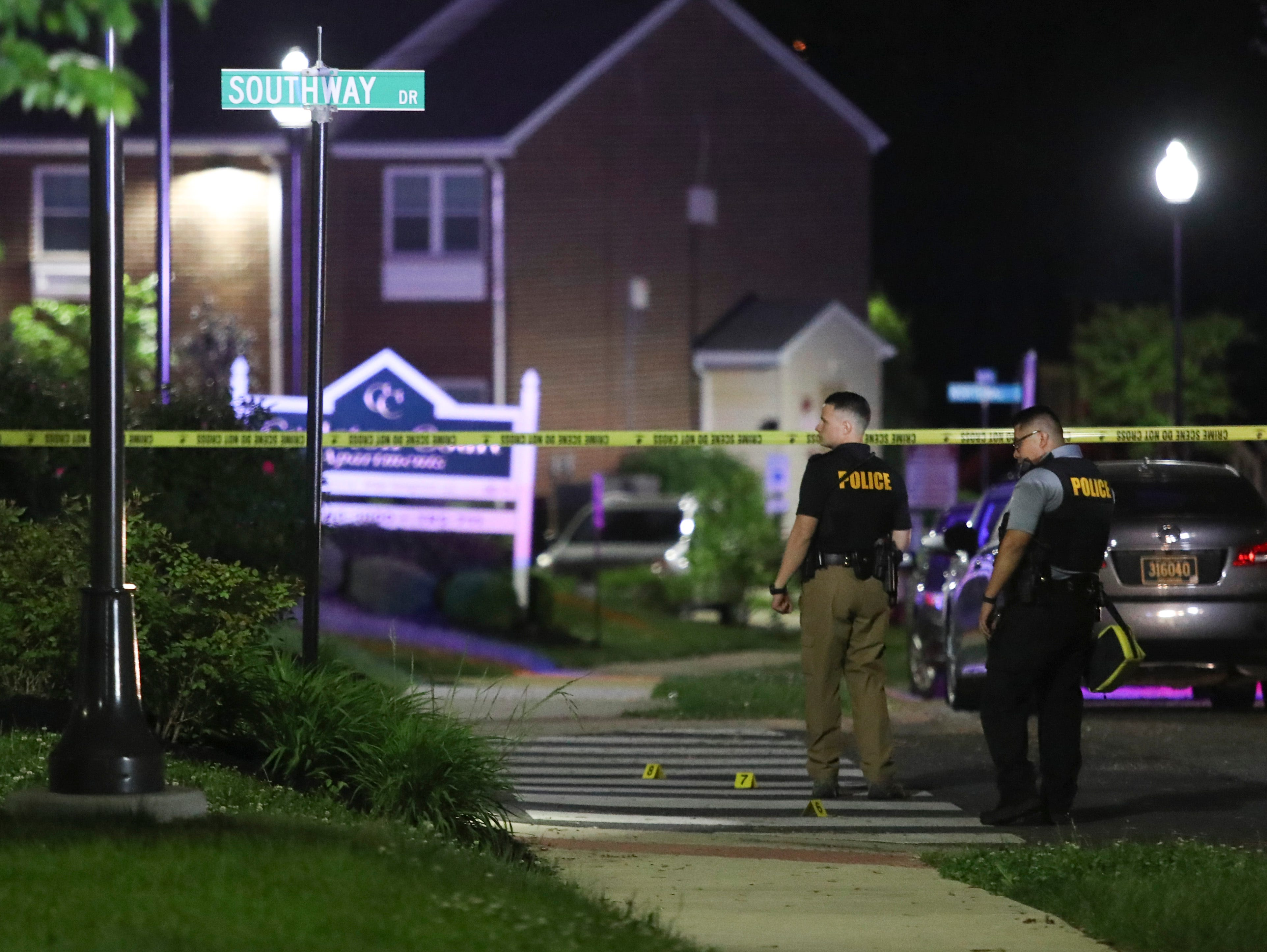 New Castle County Police investigate at the scene of a reported shooting on Kimberton Drive in Ogletown late Wednesday.