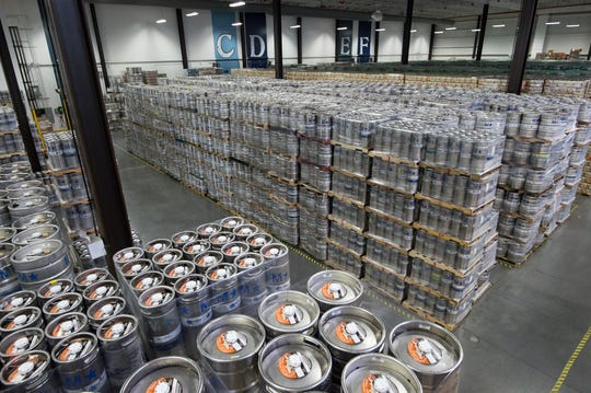 Rows and rows of beer are ready for shipment at Dogfish Head Brewery in Milton.