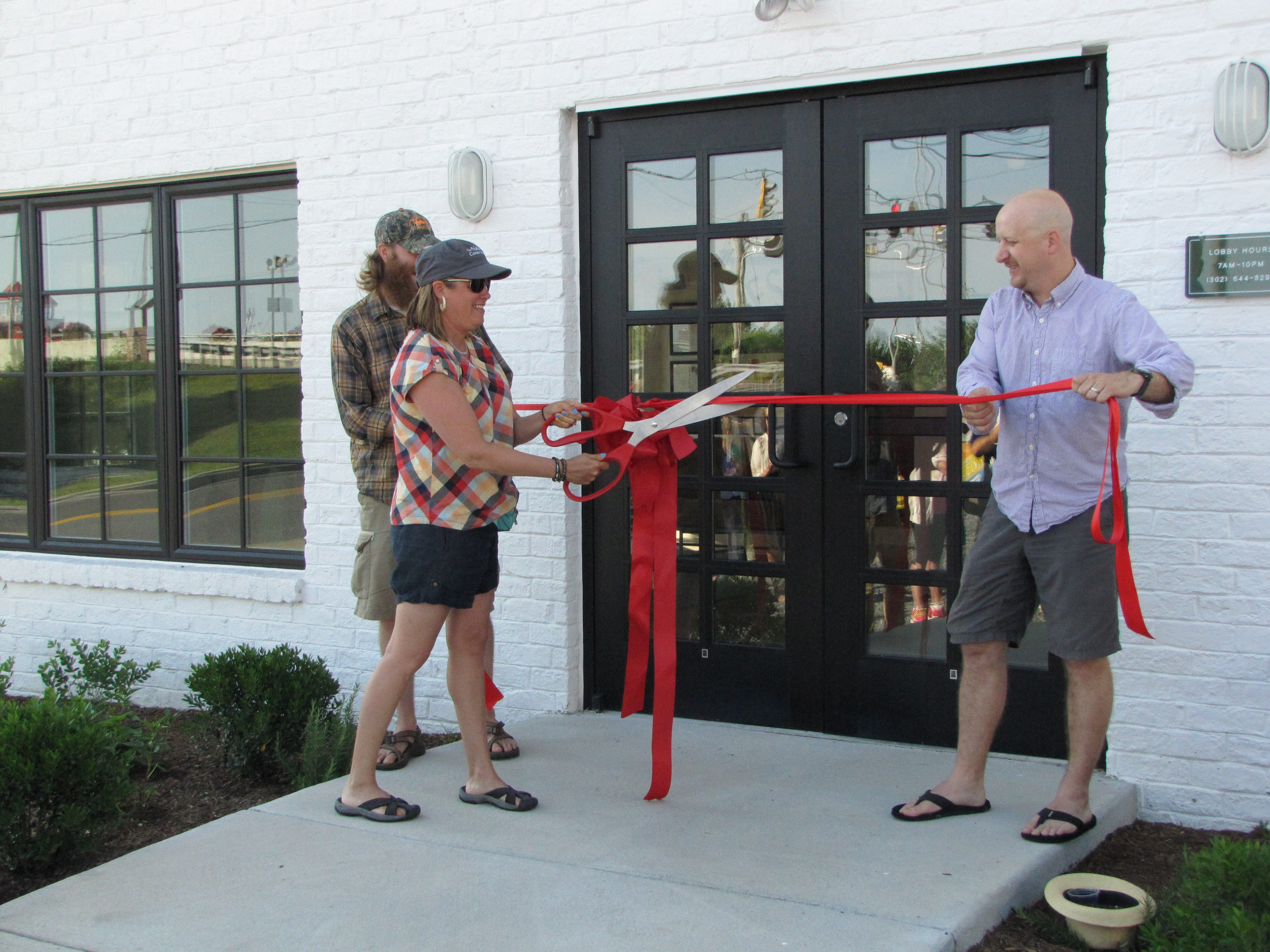 Dogfish Head's Mariah Calagione cuts the ribbon at the then-new Dogfish Inn in Lewes in July 2014.