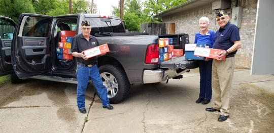 """DAV teams up up with Betty Ricks of Camp Fire NorthTexas in preparing to send candy to our troops """"down range."""" Candy will be going to the fighting men and women on the front lines. Pictured, left to right: Vice Cmdr. Larry Main; Camp Fire Executive Director BettyeRicks and Cmdr. Joel Jimenez of Disabled American Veterans Chapter 41."""