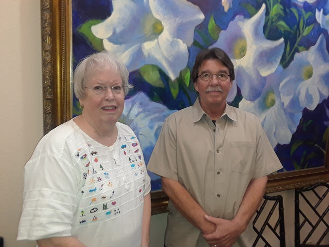 """Linda Smith, left, won first place for her poem """"Swan Song"""" in the April competition held by the Wichita Falls Poetry Society. Mark Sutton, right, placed second with his poem """"Deep Underground."""" Not pictured is third-place winner Rosellen Sheetz."""