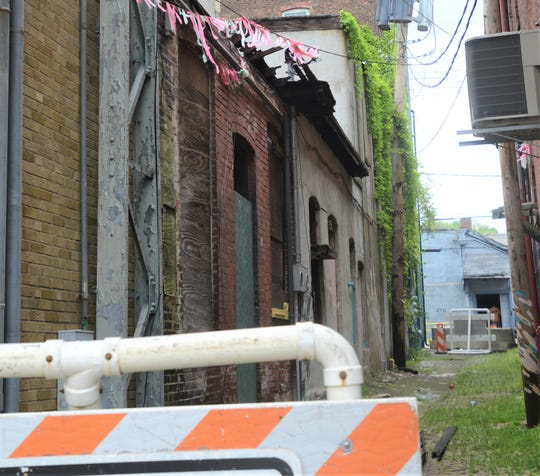 The alley behind the properties on the 600 block of Main Street have been closed due to deterioration of three properties, 606, 608 and 610 Main St.