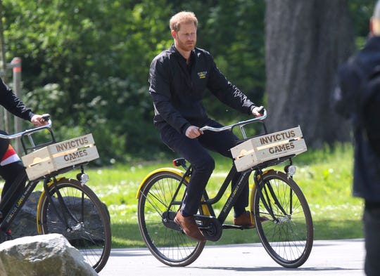 Prince Harry tours the site for the 2020 Invictus Games in The Hague on a bike, on May 9, 2019, in The Netherlands.