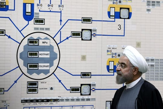 Iranian President Hassan Rouhani visits the Bushehr nuclear power plant in southern Iran, on Jan. 13, 2015.