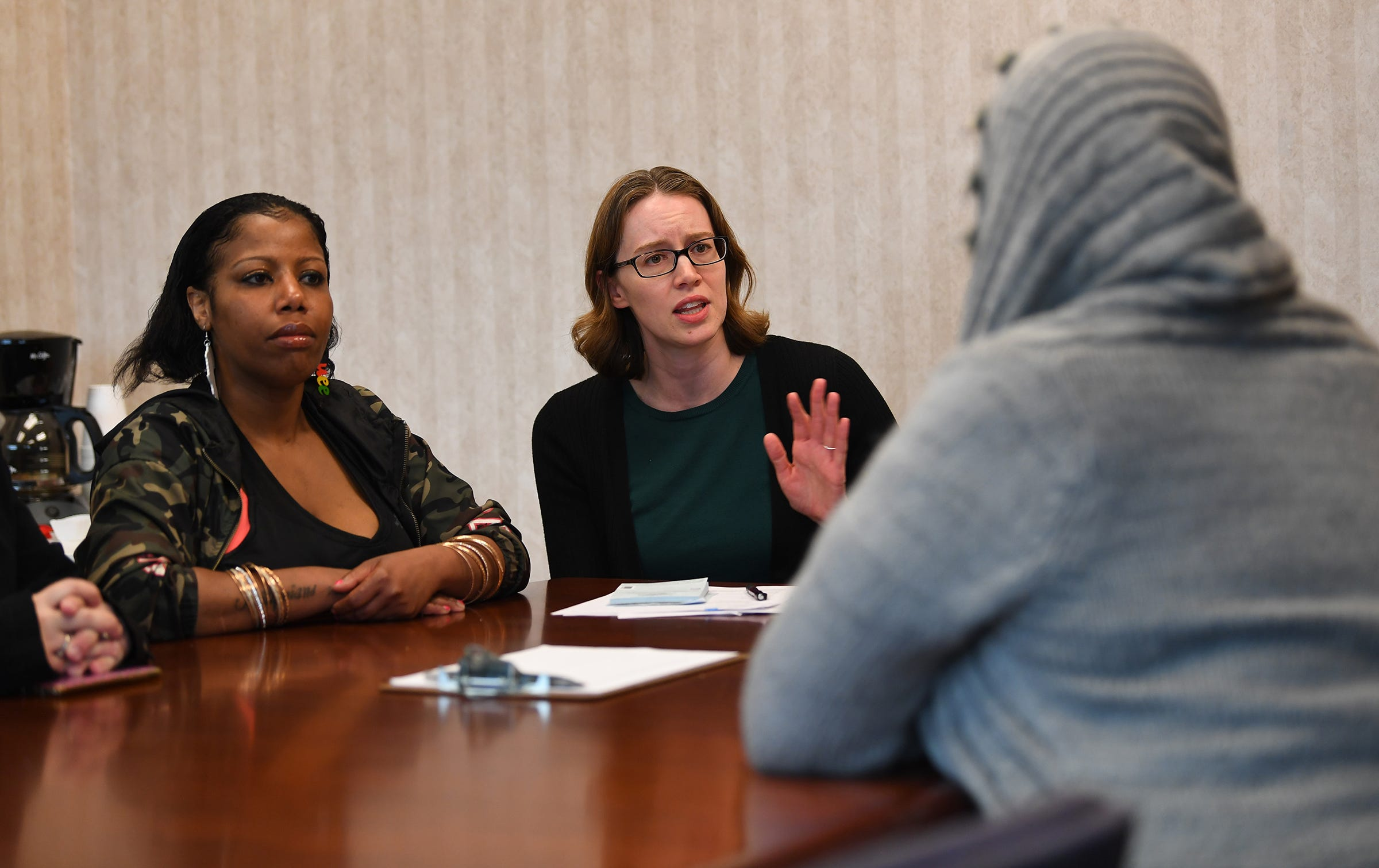 Dr. Erin Zerbo, center, assistant professor in the department of psychiatry at Rutgers New Jersey Medical School, talks with a group of patients, including Cydiaa Williams at left.