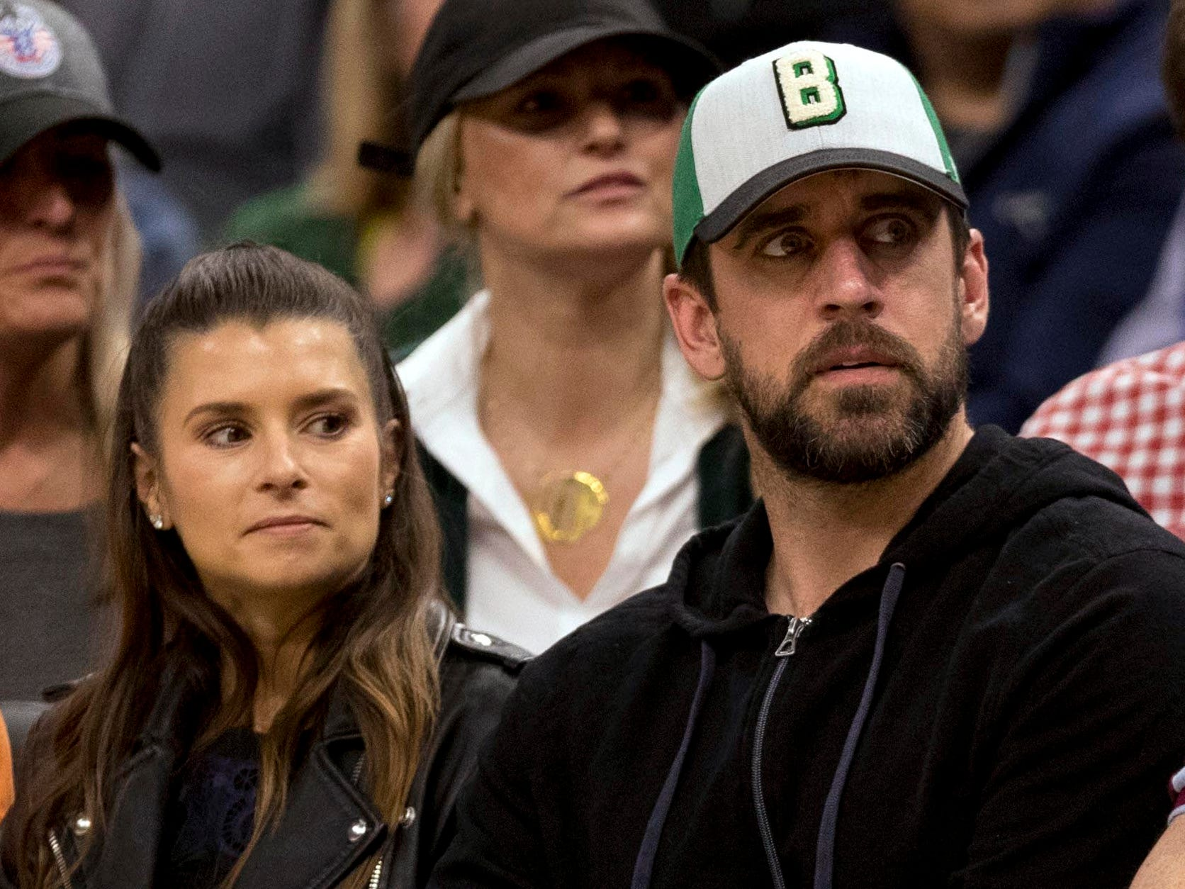 May 8: Danica Patrick and Green Bay Packers quarterback Aaron Rodgers watch the Bucks rout the Boston Celtics during Game 5 in Milwaukee.