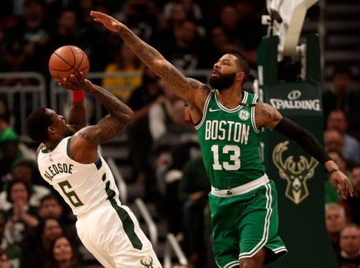 May 8: Bucks guard Eric Bledsoe (6) shoots against Boston Celtics forward Marcus Morris (13) during Game 5. Milwaukee won 116-91.
