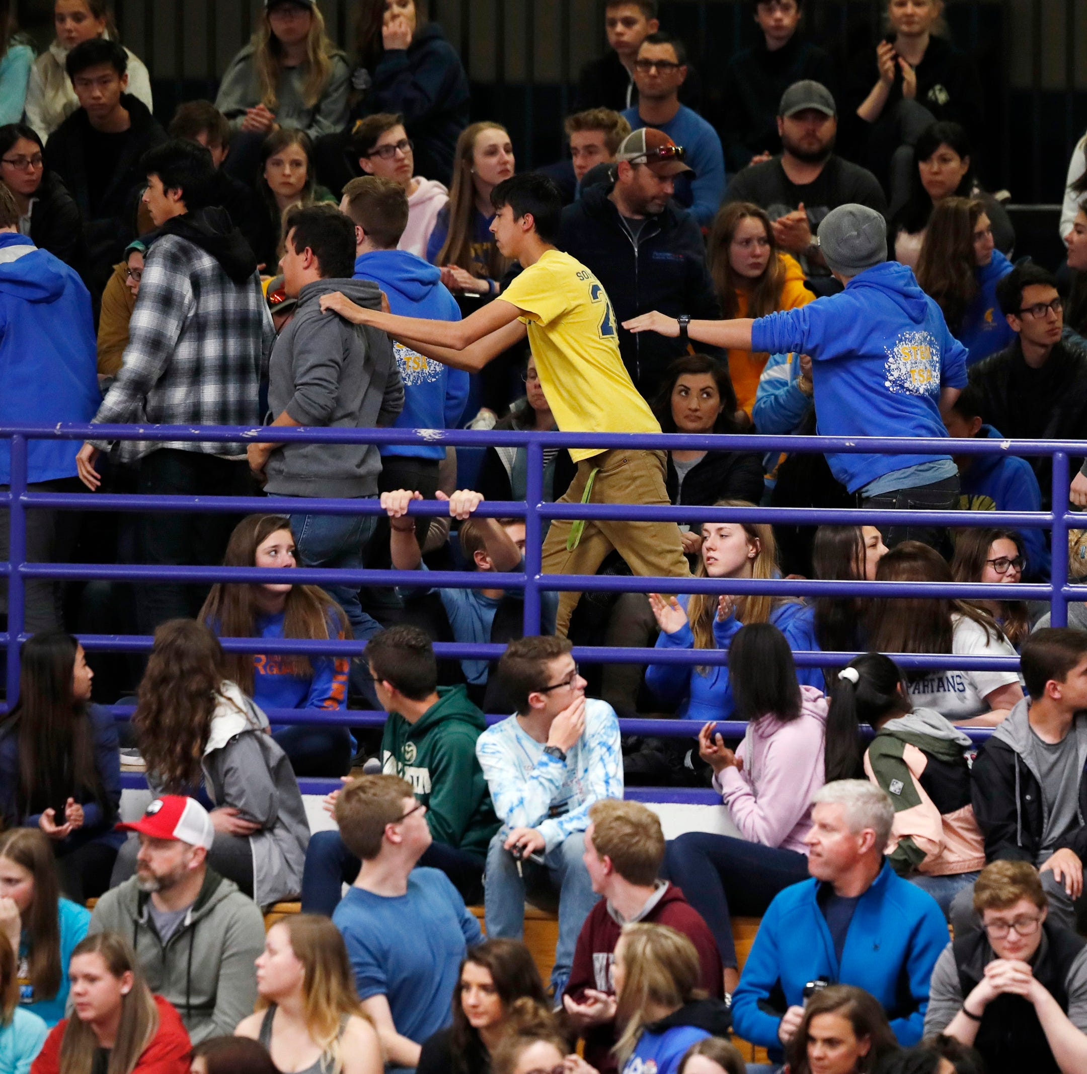 Students leave during a community vigil held to honor the victims and survivors of yesterday's fatal shooting at the STEM School Highlands Ranch, late Wednesday, May 8, 2019, in Highlands Ranch, Colo.