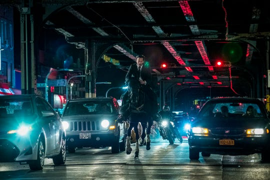 "Master assassin John Wick (Keanu Reeves) is chased on horseback by some motorcycle thugs in ""John Wick: Chapter 3 – Parabellum."""