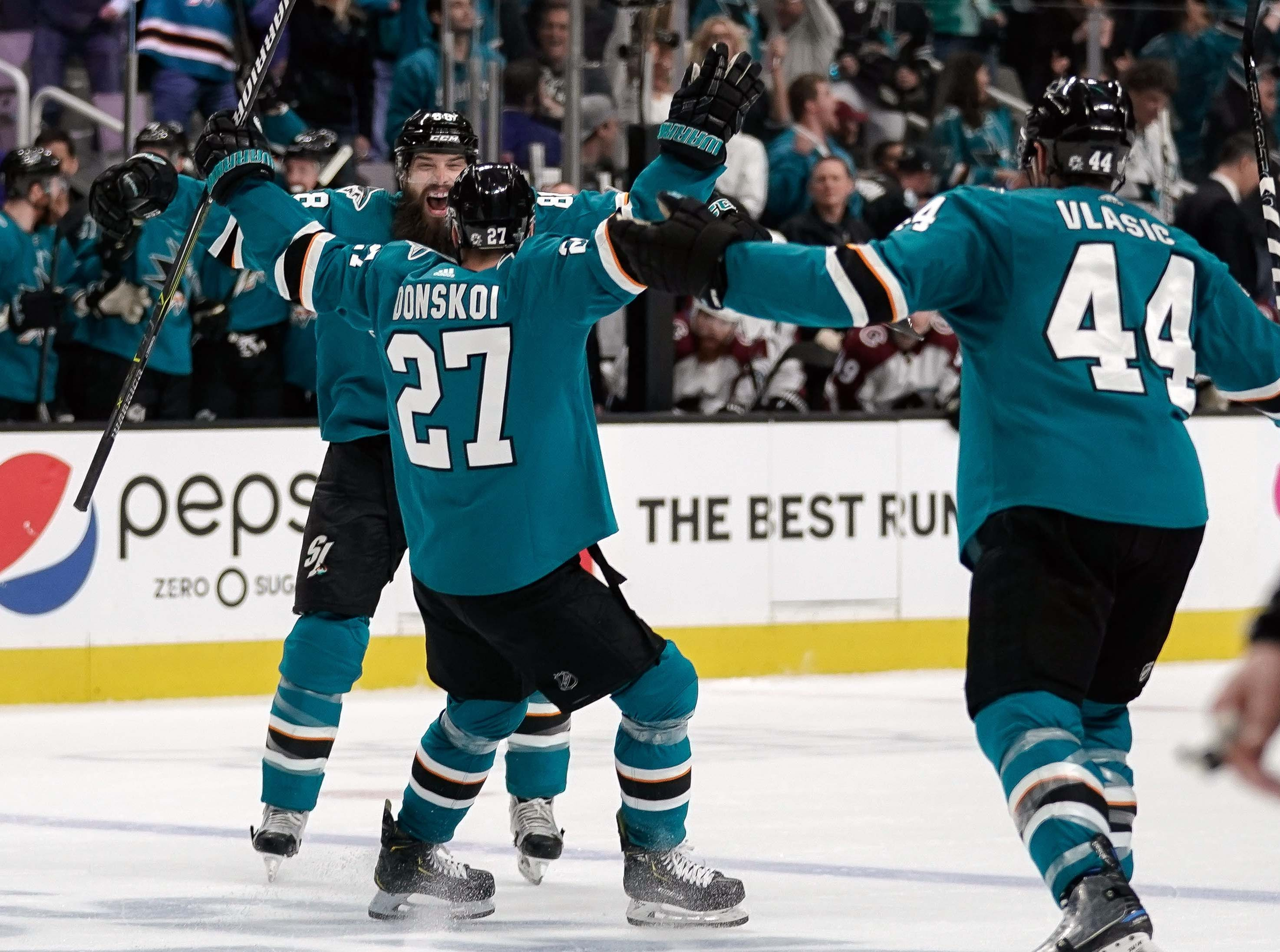 Second round: San Jose Sharks forward Joonas Donskoi celebrates with defensemen Brent Burns and Marc-Edouard Vlasic after scoring a goal in the second period in Game 7 against the Colorado Avalanche.