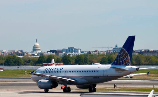 A United Airlines Airbus A319-100 taxis  at Ronald Reagan Washington National Airport on April 23, 2019.