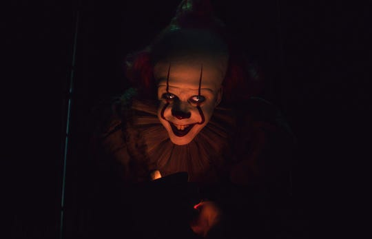 """Pennywise the clown (Bill Skarsgard) returns to haunt Derry again in """"It: Chapter Two."""""""