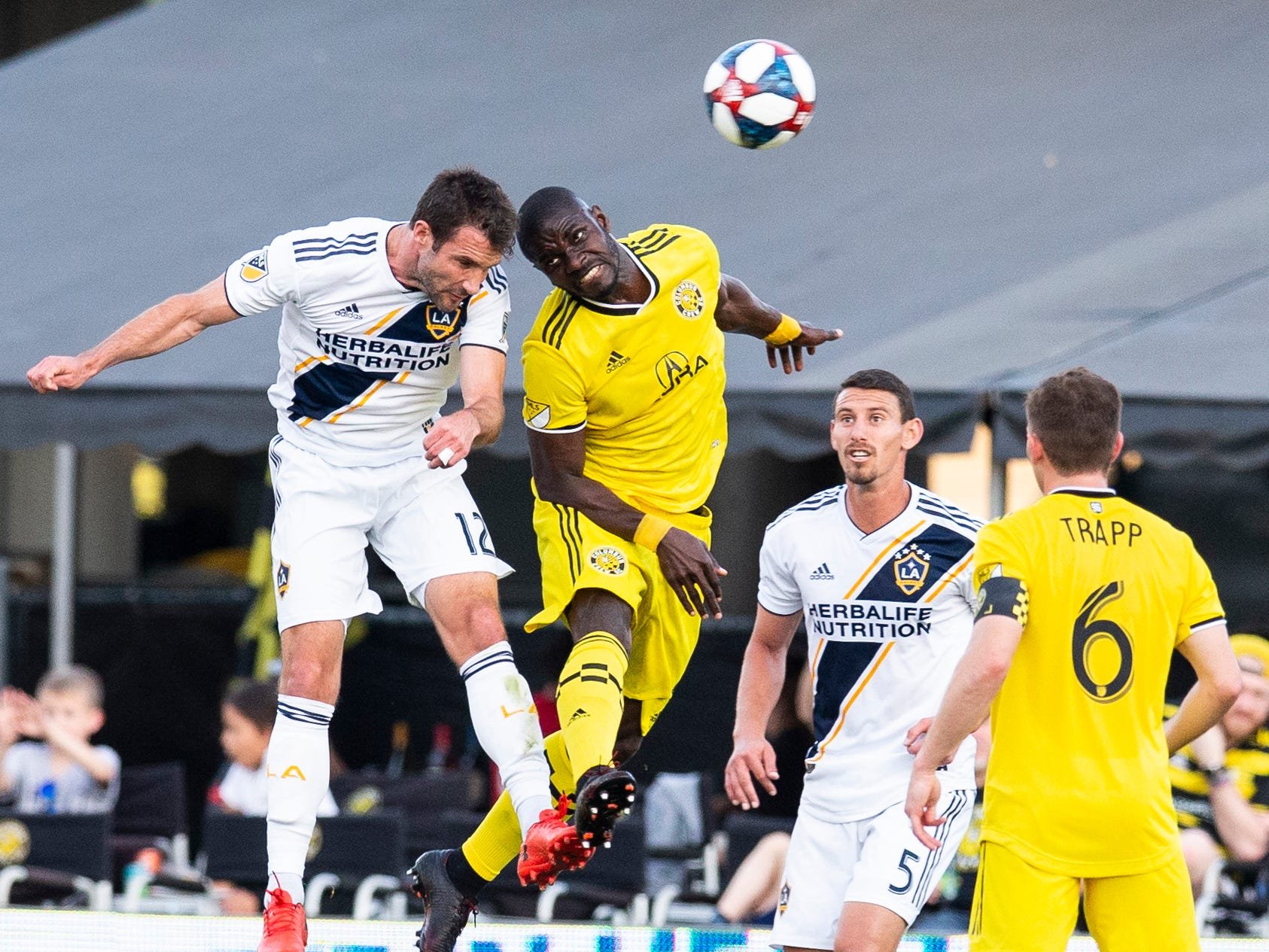 May 8: Los Angeles Galaxy forward Chris Pontius (12) and Columbus Crew SC defender Jonathan Mensah (4) battle for the ball in the air at MAPFRE Stadium. Columbus won the game, 3-1.