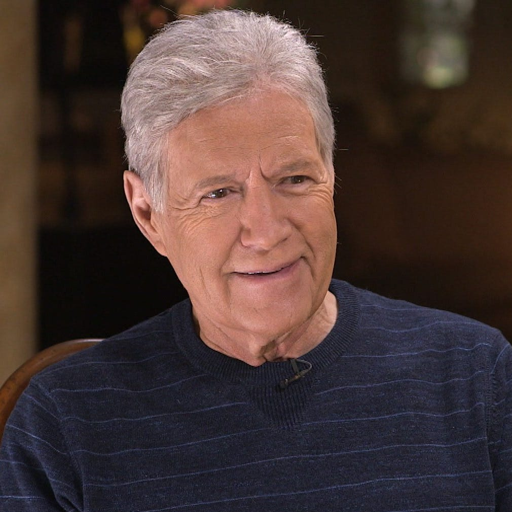 Alex Trebek says that although he's been told his chemo wig looks better than his real hair, he hopes to grow his own back over the summer hiatus.