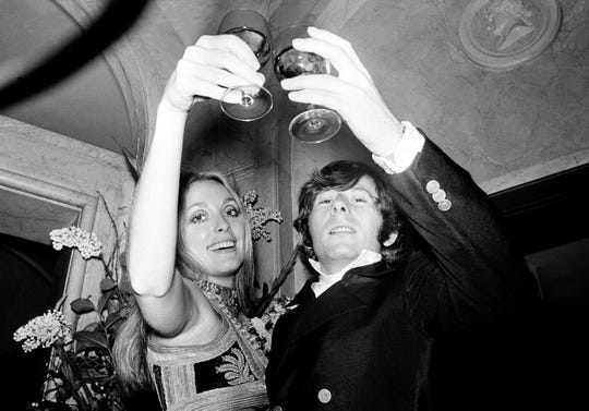 "Sharon Tate and her husband, director Roman Polanski, lift their glasses in a toast at the premiere of ""Rosemary's Baby"" in London on Jan. 23, 1969."