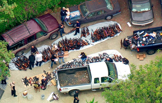 This photo from video provided by KCBS/KCAL-TV shows investigators from the U.S. Bureau of Alcohol, Tobacco, Firearms and Explosives and the police inspecting a large cache of weapons seized at a home in the affluent Holmby Hills area of Los Angeles Wednesday, May 8, 2019. Authorities seized more than a thousand guns from the home after getting an anonymous tip regarding illegal firearms sales in a posh area near the Playboy Mansion and served a search warrant around 4 a.m. Wednesday at the property on the border of the Bel Air and Holmby Hills neighborhoods.