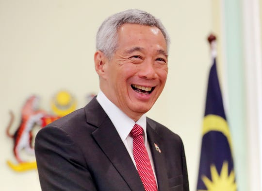 Singaporean Prime Minister Lee Hsien Loong smiles after a press conference with Malaysian Prime Minister Mahathir Mohamad in Putrajaya, Malaysia, on Tuesday, April 9, 2019. Singapore reportedly has passed a law criminalizing the publication of fake news and allowing the government to block and order the removal of such content.