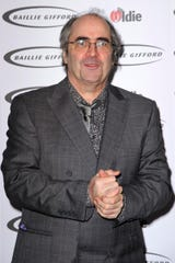 British radio host Danny Baker, seen here at a 2013 award ceremony, was fired from the BBC after posting what was perceived as a racist tweet about the new royal baby.