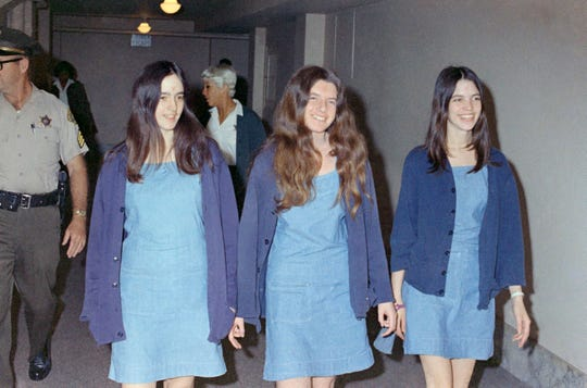 FILE - Charles Manson followers Susan Atkins (far left), Patricia Krenwinkel and Leslie Van Houten are shown walking to court to appear for their roles in the 1969 cult killings of seven people, including pregnant actress Sharon Tate.