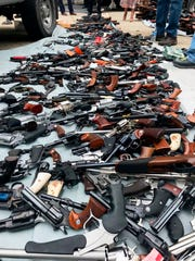 This photo provided by the Los Angeles Police Department shows part of a large cache of weapons seized at a home in the affluent Holmby Hills area of Los Angeles Wednesday, May 8, 2019 by police and ATF officers.
