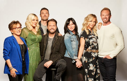 """The """"BH90210"""" cast, from left to right:   Gabrielle Carteris, Tori Spelling, Brian Austin Green, Jason Priestley, Shannen Doherty, Jennie Garth and Ian Ziering."""